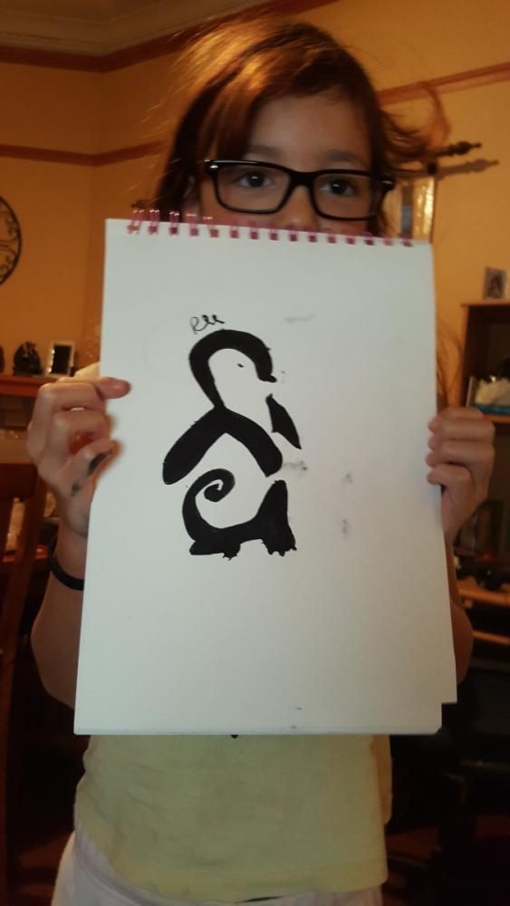 10yo with a positive and negative space penguin