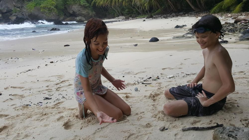 10yo squealing and carrying on while trying to hold a small crab at Dolly Beach, Christmas Island