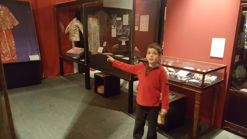 7yo looking at traditional Chinese clothes, Chinese Museum, Melbourne, Australia