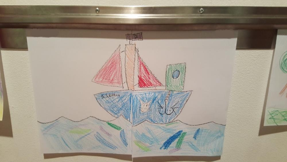 9yo and her 10yo bestie collaborated on a picture of a boat, 10yo drew and 9yo coloured
