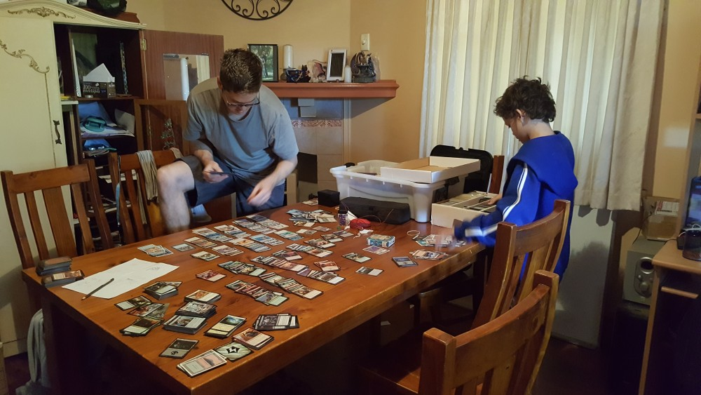 Big boys sorting through Magic The Gathering cards