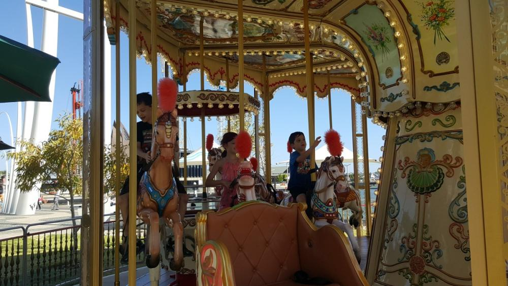 Kids on the carousel at Elizabeth Quay, Perth, Western Australia