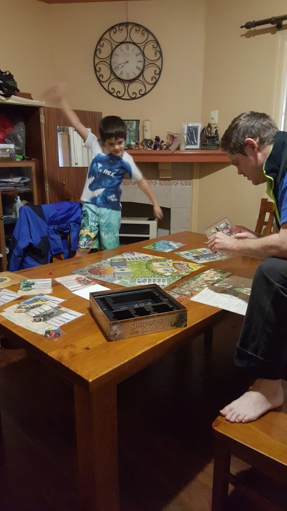 J and 7yo playing Shadows Over Camelot
