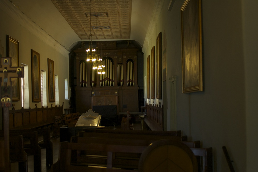 Church interior showing tomb and pipe organ, New Norcia, Western Australia