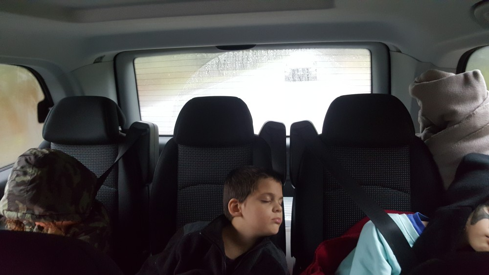 Kids asleep in the back of the car after snow play