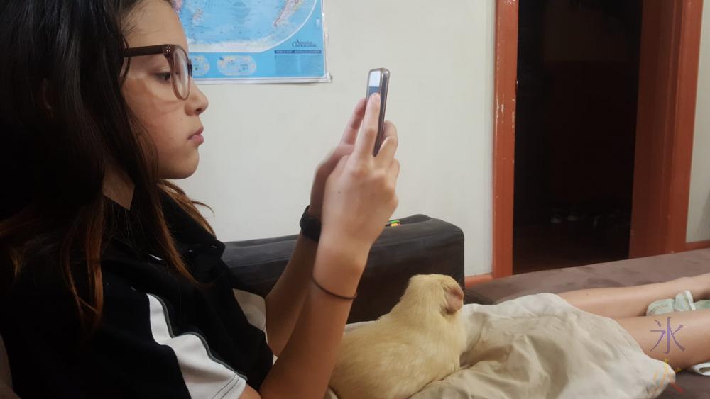 11yo-on-phone