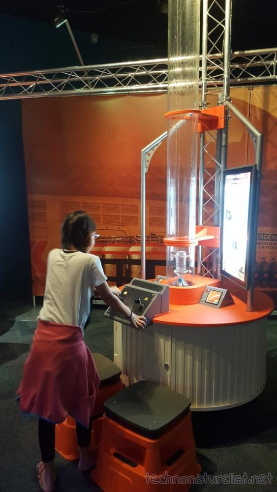 11yo working out bottle rocket mix, Planet Pioneers exhibition, SciTech, Perth, Western Australia