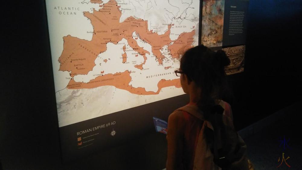 11yo-studying-map-pompeii-exhibition