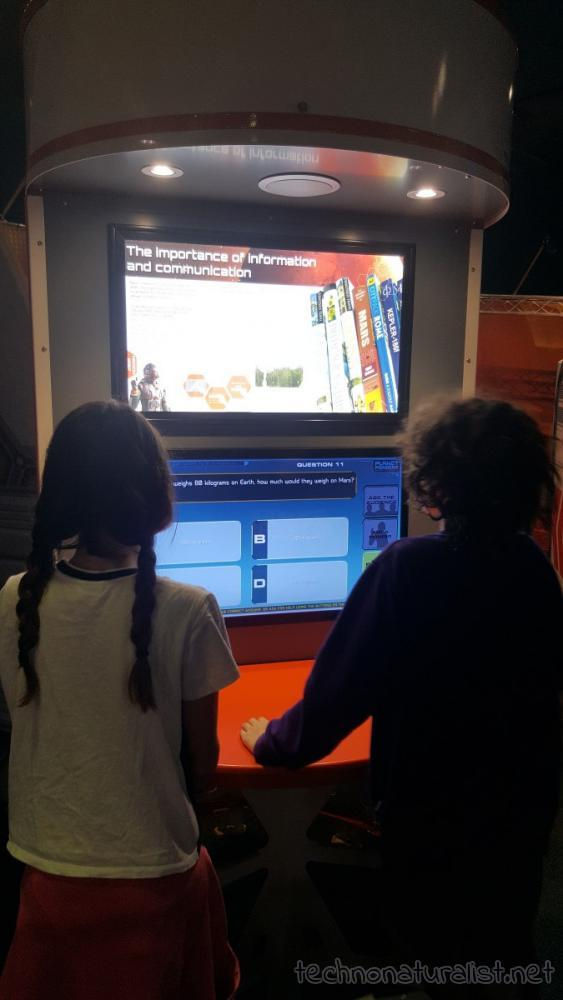 13yo and 11yo playing a multichoice game at SciTech, Perth, Western Australia