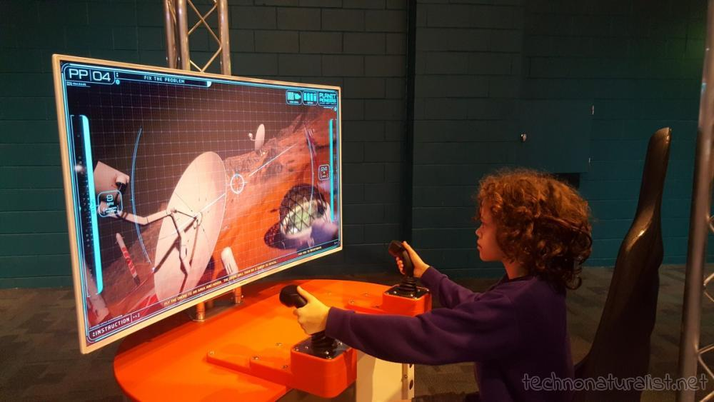 13yo using drone sim at Planet Pioneers exhibition, SciTech, Western Australia