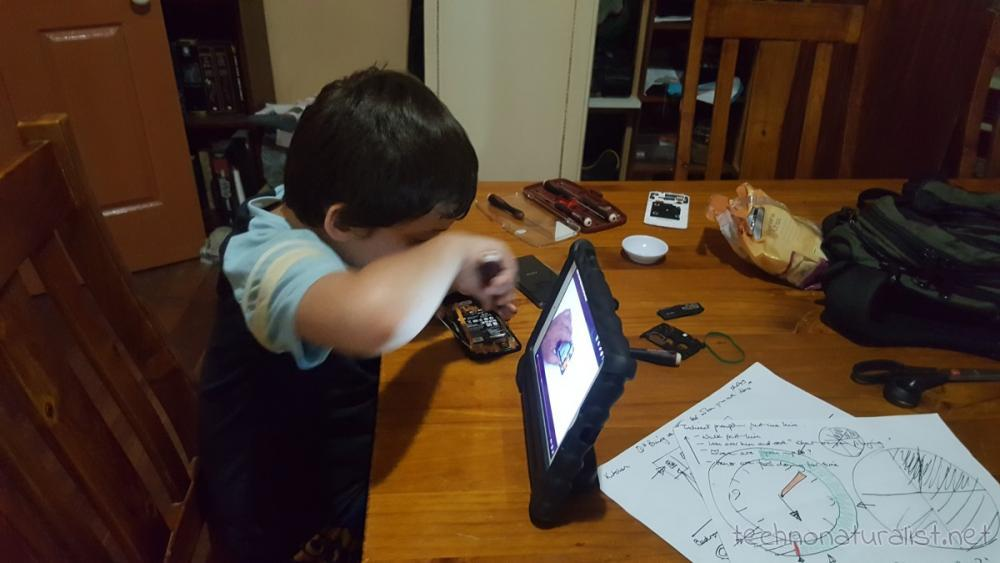 8yo-dismantling-old-phone