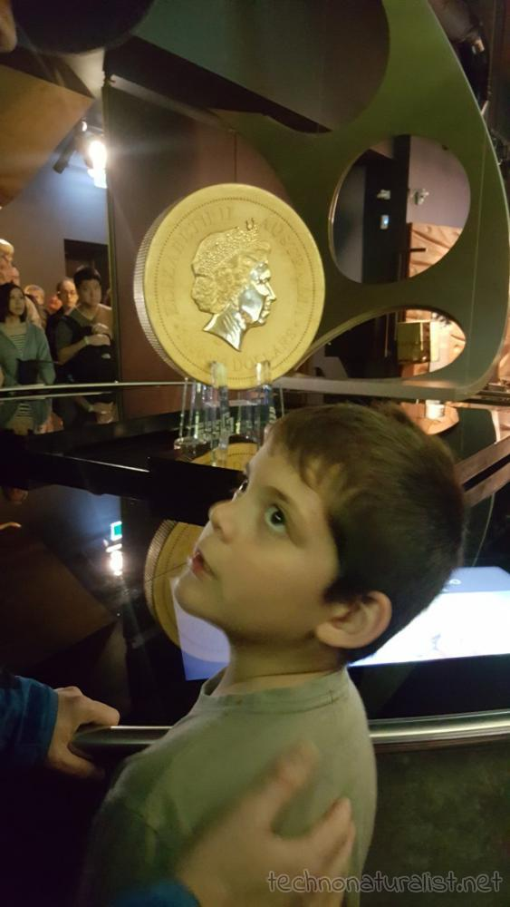 8yo-looking-at-giant-gold-coin-perth-mint