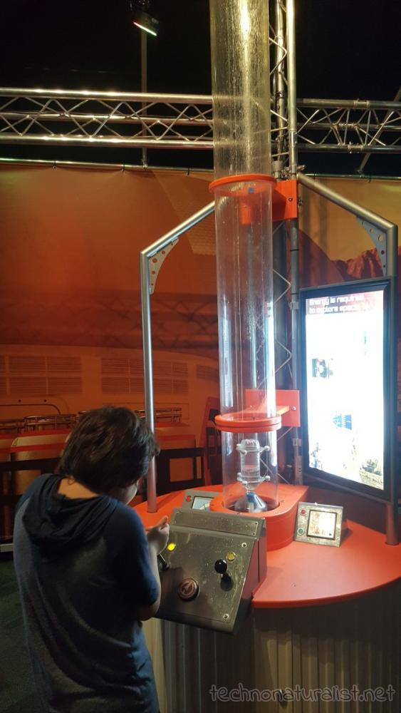 9yo working out bottle rocket mix, Planet Pioneers exhibition, SciTech, Perth, Western Australia