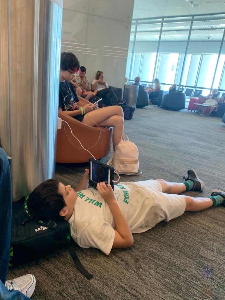 13yo and 11yo chilling near the boarding gate at Perth Airport, Western Australia