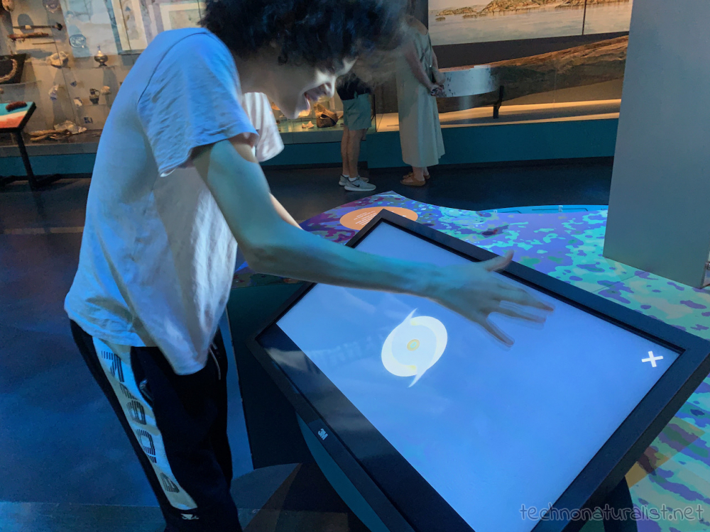 16yo making a cyclone on interactive display in Boola Bardip Museum, Perth, Western Australia