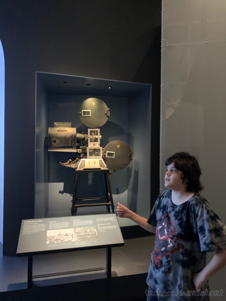 12yo looking at old film camera