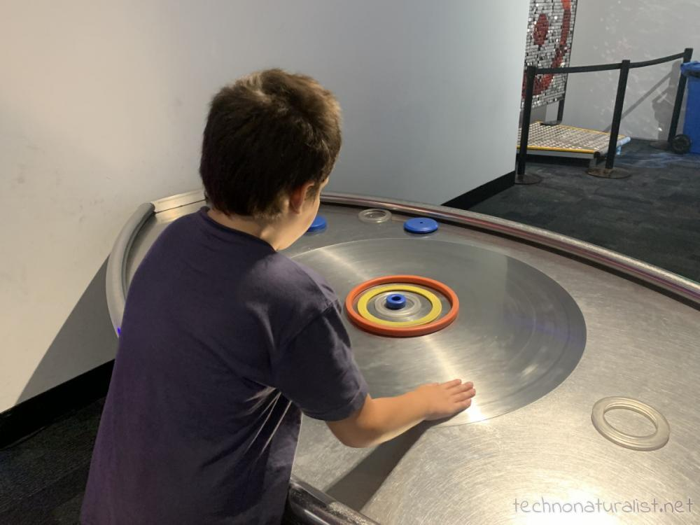 10yo playing with orbits at Scitech, Perth, Western Australia