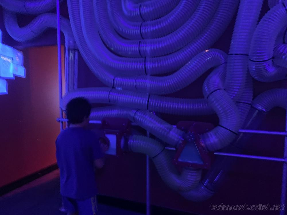 10yo playing with air valve maze at Scitech, Perth, Western Australia