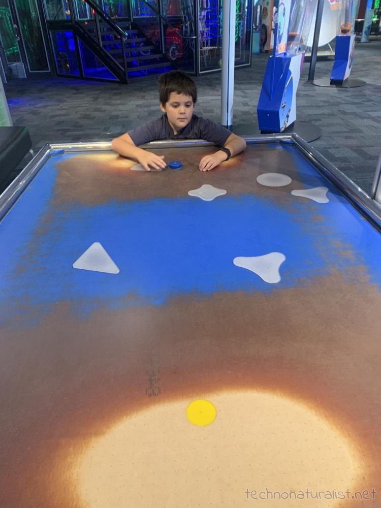 10yo playng with collision objects at Scitech, Perth, Western Australia