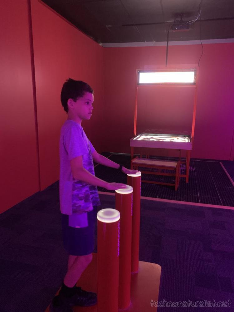 14yo playing with light display at Scitech, Perth, Western Australia