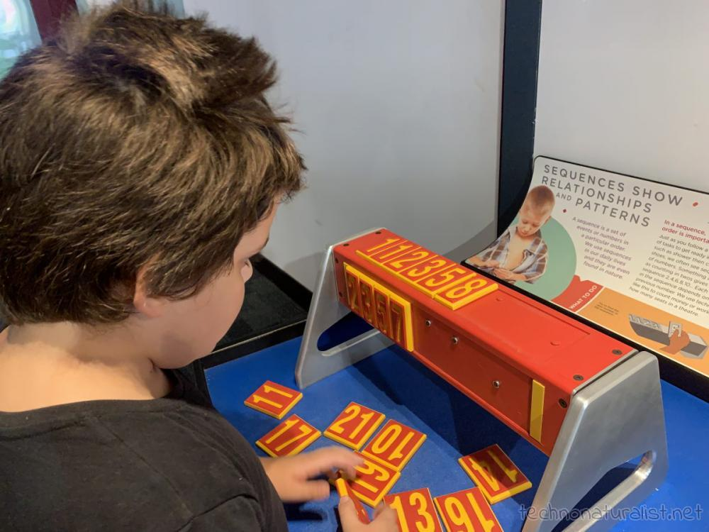 10yo working out number patterns at Scitech, Perth, Western Australia