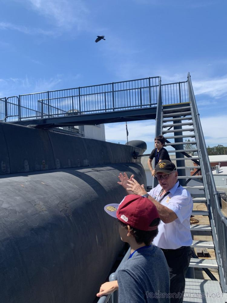 HMAS Ovens guide explaining submarine parts at the Maritime Museum, Fremantle, Western Australia