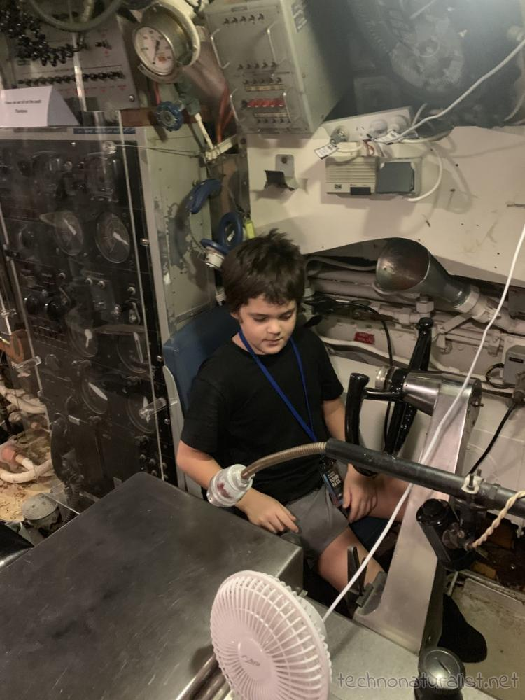 10yo in driver's seat of HMAS Ovens, Maritime Museum, Fremantle, Western Australia