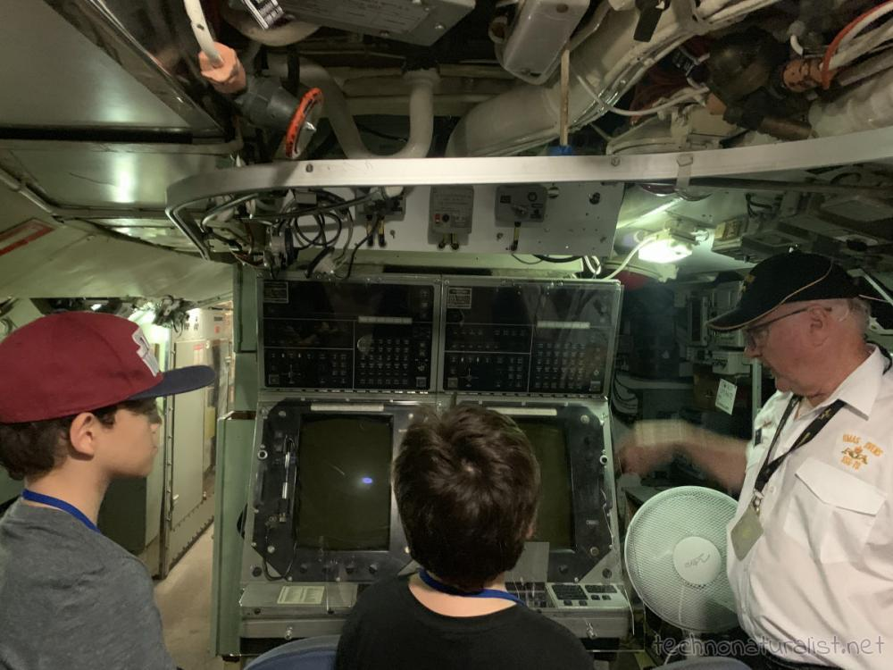 Boys looking at control room equipment on HMAS Ovens, Maritime Museum, Fremantle, Western Australia