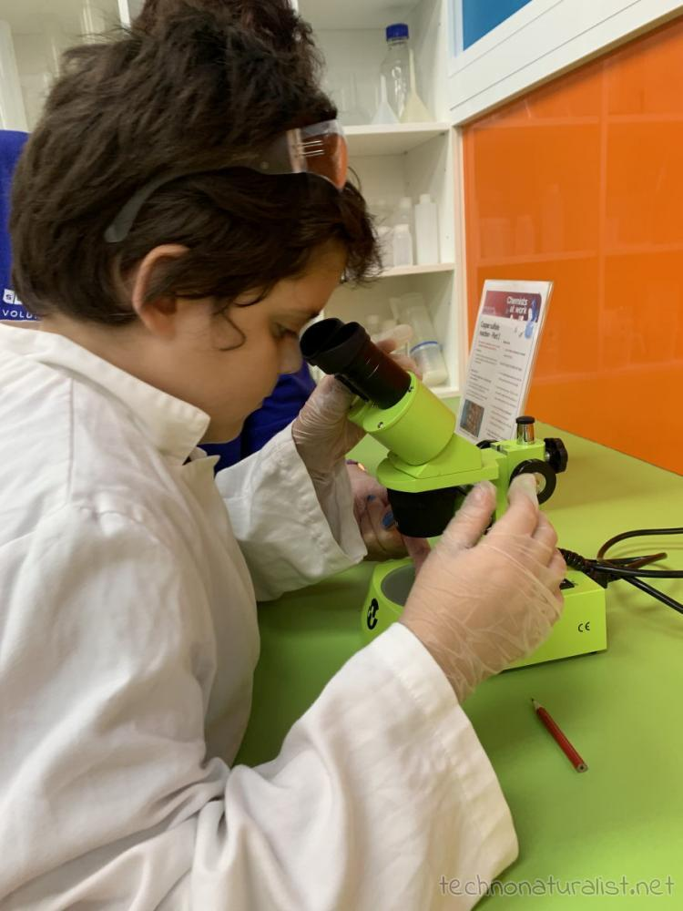 10yo looking through microscope in geochemistry unit at Scitech, Perth, Western Australia