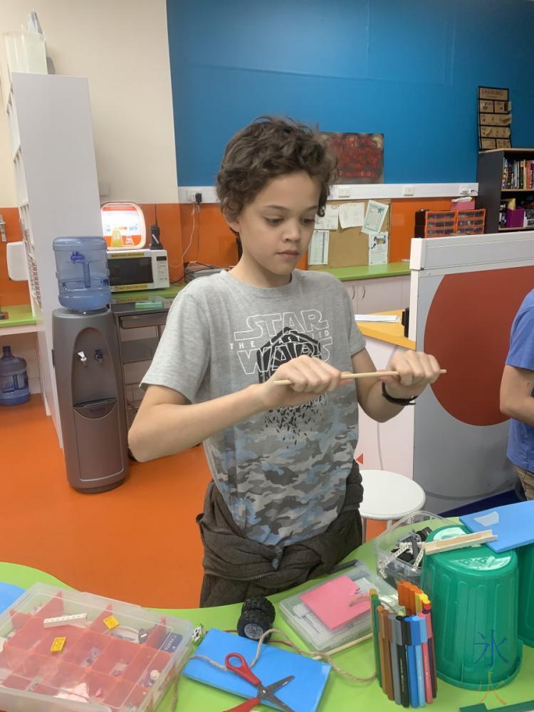 14yo helping build Rube Goldberg machine