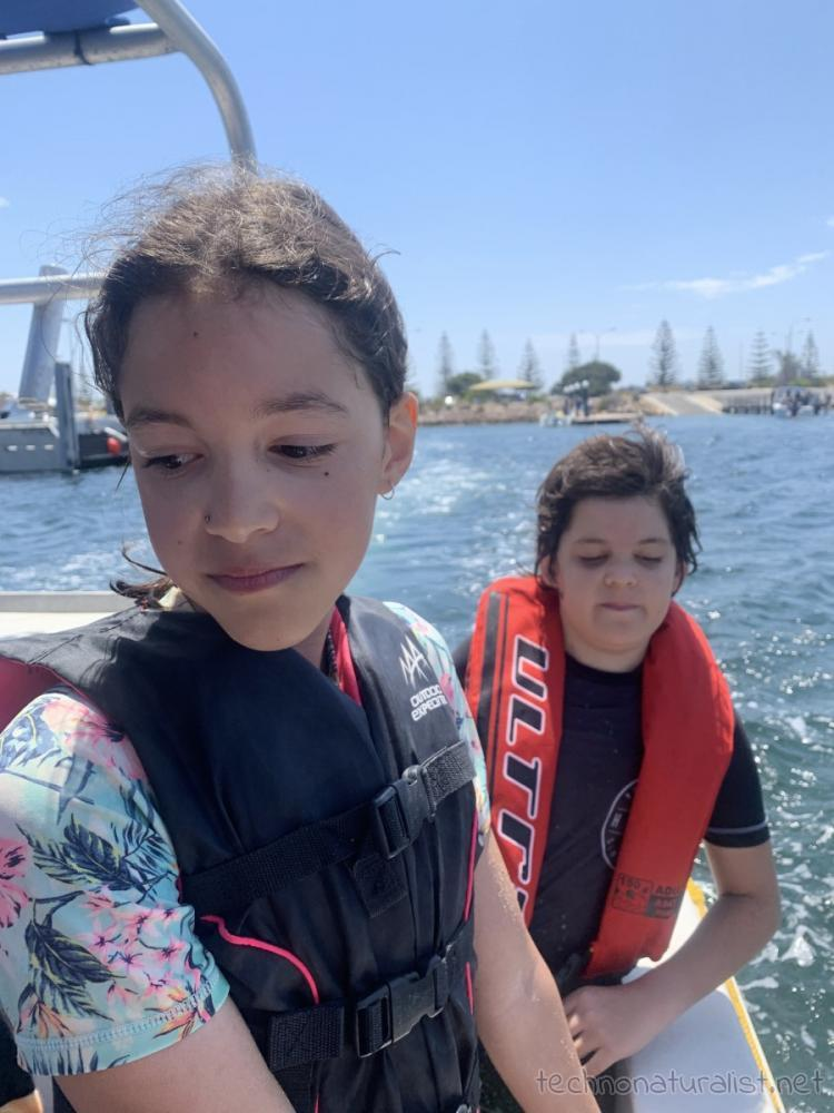 12yo and 10yo on the boat at Jurien Bay