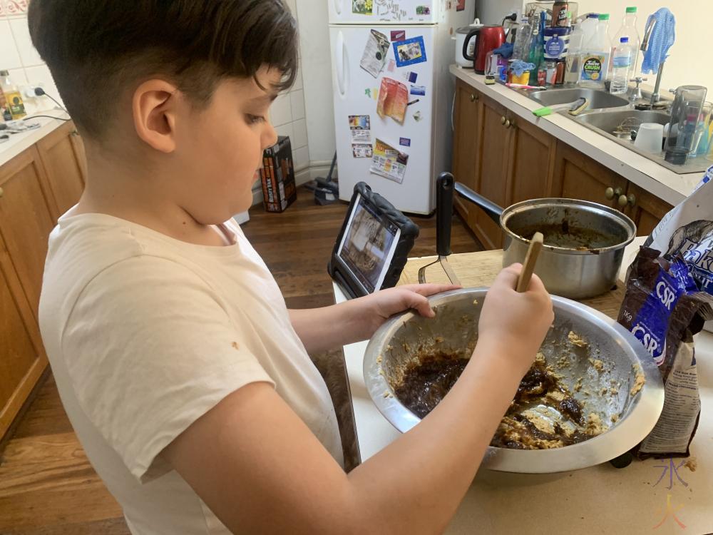 11yo making sticky date pudding I think