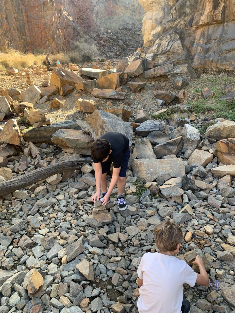 11yo and 8yo make rock balance sculptures