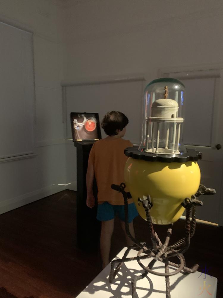 11yo looking at art exhibits at Heathcote Gallery, Applecross, Western Australia