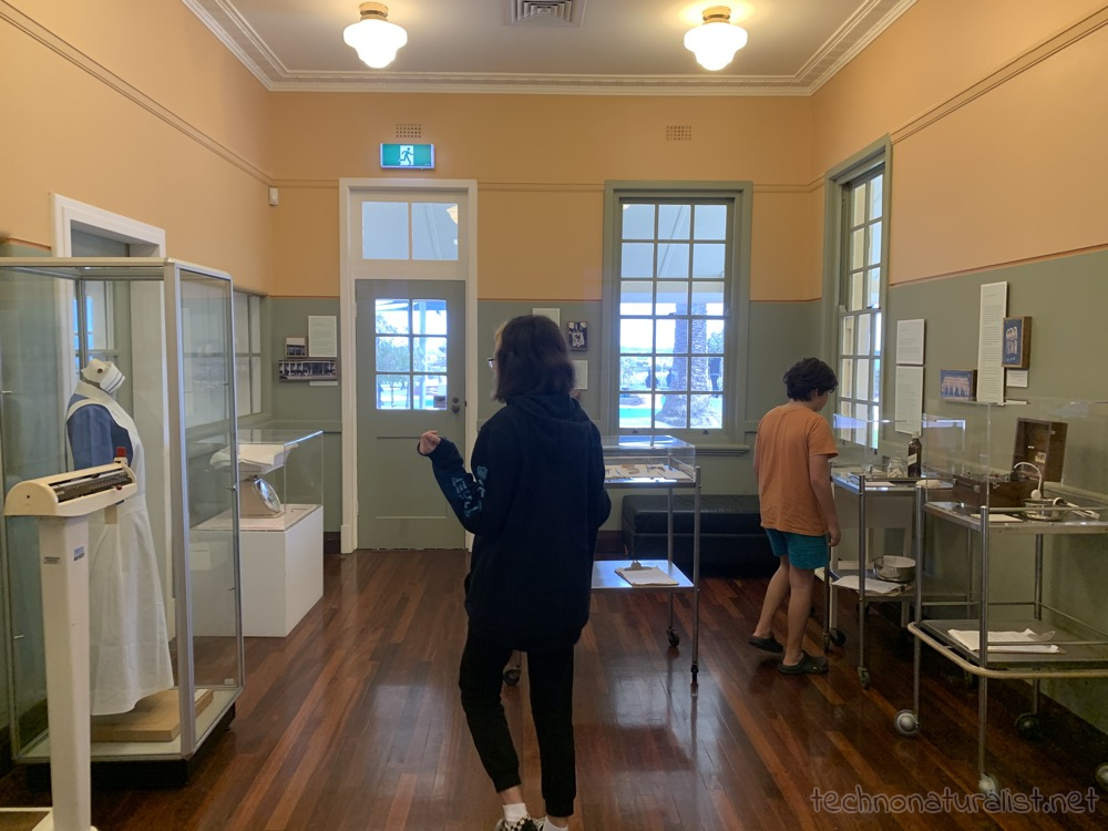 13yo and 11yo looking in the one-room Heathcote Museum, Applecross, Western Australia
