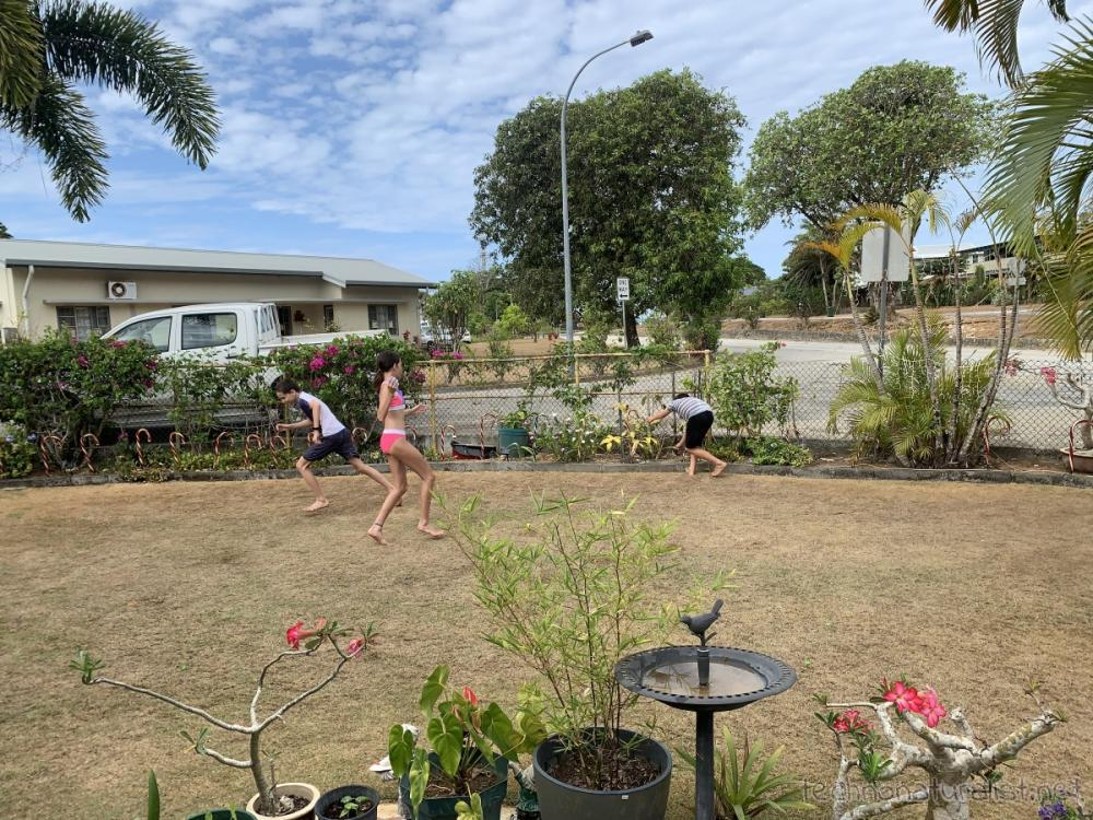 water balloon fight at grandparents place, Christmas Island