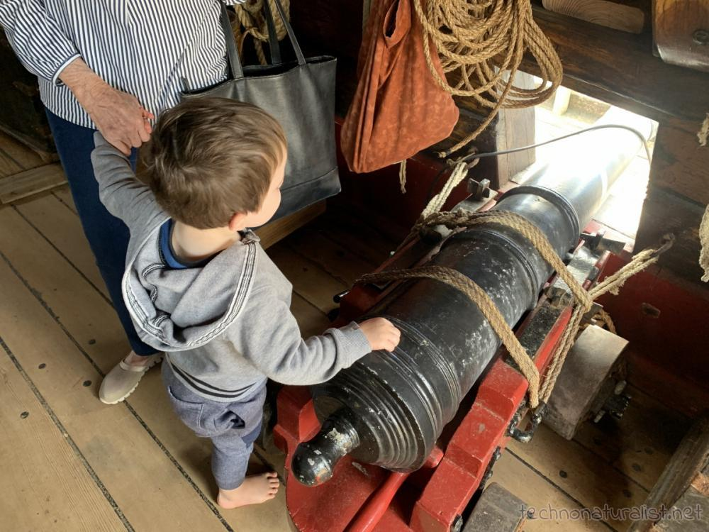 3yo checking out ship cannon aboard Duyfken replica, AQWA, Western Australia