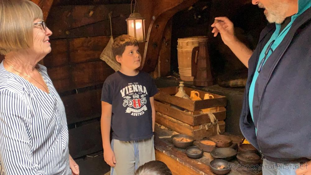 10yo listening o guide talk about spices and stuff aboard Duyfken replica, AQWA, Western Australia