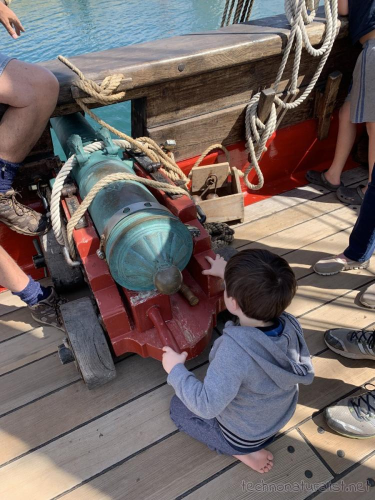 3yo playing with cannon on board Duyfken replica, AQWA, Western Australia