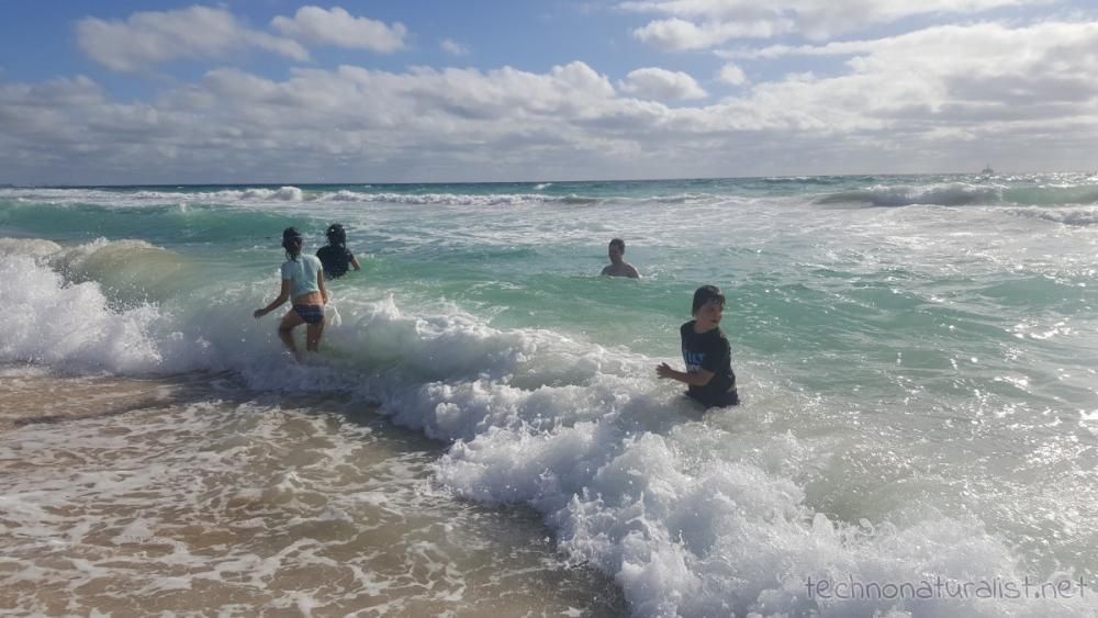 kids-playing-in-waves